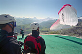 In preparation for paragliding, near Corvara, Dolomites, Alta Badia South Tyrol. Italy