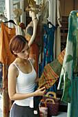 Young woman at a boutique, Positano, Campania, Italy, Europe