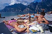 Teenagers on the Lakeside, Torbole, Lago di Garda Trentino, Italy