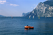 Child in a rubber dinghy on a lake, Torbole, Lago di Garda, Trentino, Italy, Europe