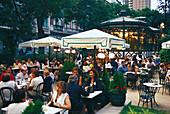 People sitting under sunshades at Café del Espejo, Paseo de Recoletos, Madrid, Spain, Europe