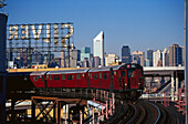 Subway driving on a bridge under clear sky, Queens, Manhattan, New York, USA, America