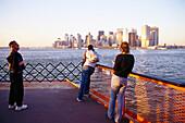 Passengers on Staten Island Ferry, Downtown Manhatten New York, USA