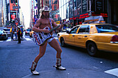 Half naked cowboy with guitar at Times Square, Manhattan, New York, USA, America