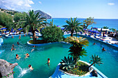 People at a pool under palm trees, Apollo, Aphrodite therm, Ischia, Campania, Italy, Europe