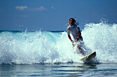 Surfer on a wave in the sunlight, Costa Rica, Caribbean, America