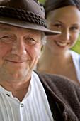Older Bavarian man and young woman, Munich, Bavaria