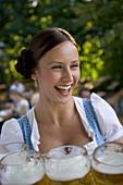 Young waitress in beer garden, Munich, Bavaria