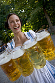 Waitress with beer glasses, Starnberger See Bavaria, Germany