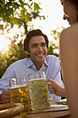 Young couple sitting in a beer garden, Lake Starnberg, Bavaria, Germany