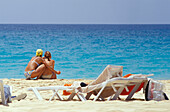 Two woman looking at the sea, Beach of Santa Maria, Sal, Cape Verde Islands, Africa