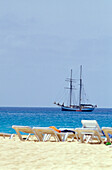 Sunloungers on the beach and sailing ship on the sea, Santa Maria, Sal, Cape Verde, Africa