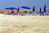 People on sunloungers on the beach, Santa Maria, Sal, Cape Verde, Africa
