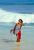 Young man with surfboard, Beach of Santa Maria, Sal, Cape Verde Islands, Africa