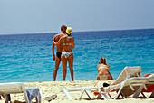 Couple looking at the sea, Beach of Santa Maria, Sal, Cape Verde Islands, Africa