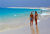 Two woman talking at beach, Beach of Santa Maria, Sal, Cape Verde Islands, Africa