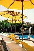 Deck chairs, sunshades and pool, Beach of Santa Maria, Sal, Cape Verde Islands, Africa