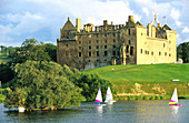Sailing boats on a lake in front of Linlithgow Palace, West Lothian, Scotland, Great Britain, Europe