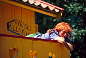 Young woman wearing a wig at theme park Astrid Lindgrens Värld, Vimmerby, Smaland, Sweden, Europe