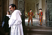 Swiss guard, a priest and a nun at the Vatikan, Rome, Italy