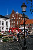 Market on Stortorget square under blue sky, Ystad, Scania, Sweden, Europe