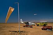 A car and an airplane standing on a runway, Innamincke, South Australia, Australia