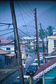 View at the main street of the village Hillsborough in the rain, Carriacou island, Grenada, Caribbean, America
