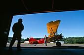 View from a hangar at an airplane under a blue sky, Washington, USA