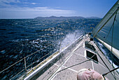 Bow of a sailing boat at full speed in the sunlight, Bequia Channel, St. Vincent, Grenadines, Caribbean, America