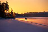 Cross country skiing on iced lake, Vastergotland, Sweden