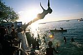 Children and Teenagers bathing at Zanzibar harbour, Tanzania, Africa