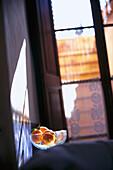 Oranges in a glass bowl, Finca Hotel de Reis, Valle de los Naranjos, Soller, Majorca, Spain, Europe