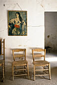 Chairs and a picture in the farm worker's room of a finca, Majorca, Spain