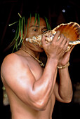 Native blowing in a shell, Tiki Theatre Village, Moorea, Polynesia
