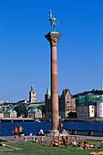 Column with statue in front of Riddarholmen under blue sky, Stockholm, Sweden, Europe