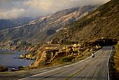 Lonesome motorbike driving on Highway 1, Cape San Martin, Lucia Range, California, USA