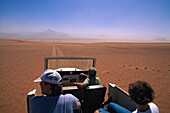 People in a jeep at the Namib Desert, Namibia, Africa