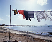 Washing drying on a washing line on the beach, Boa Vista, Cape Verde Islands, Africa