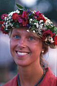 Young woman with floral wreath, Visby, Gotland, Sweden, Europe