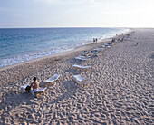 Beach with sun loungers at Santa Maria, Touristic Center, South coast, Sal, Cape Verde Islands
