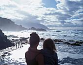 Mother holding daughter, sea water pool, Punta Grande, El Hierro, Canary Island, Spain