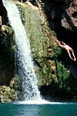 Man, Waterfall, Os Moinhos da Rocha Tavira, Algarve, Portugal