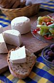 Goat cheese and bread on a table, Serra do Caldeirao, Tavira, Algarve, Portugal, Europe