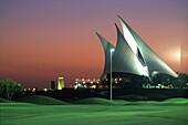The illuminated clubhouse of the Dubai Creek Golf Club in the evening, Dubai, United Arab Emirates, Asia