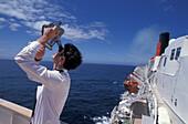 Mate aspirant measuring ship's position, sextant, bridge, Queen Elizabeth II, Transatlantic Passage, Atlantic