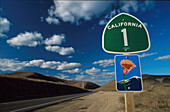 Street sign on Highway No. 1 under clouded sky, California, USA Amerika
