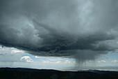 Cloudburst, dark clouds over the lowlands, Nevada, USA
