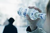 Man drinking vodka from the bottle, Omsk, Siberia