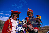 Indian children playing with dolls, brother and sister, Peru, South America