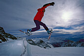 Jump with snow shoes, Hohe Tauern, Salzburger Land, Austria